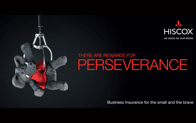 Hiscox advert with a toy elephant being lifted in the arm by a claw crane •B2B Brands
